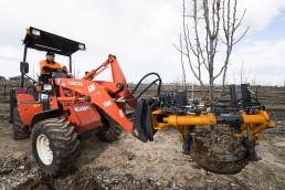man driving a machine planting tree