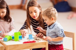 Woman playing with a child on a child care center