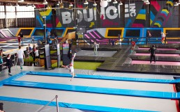 people bouncing in an indoor bouncing field