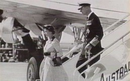 black and white picture of woman and a pilot taking off inside the plain